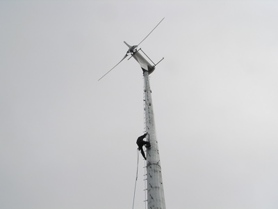 Conrad climbs the 100' high wind turbine at Ecovita